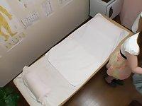 Adorable Japanese babe gets fingered in voyeur massage clip