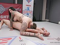 Busty tattooed raven shares the ring with her male slave
