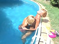 Outdoor lesbial pussy licking by the pool with a mature lesbian