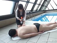 Shizuku Memori plays with a cock and teases a guy by the pool