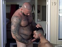 Bald man with huge muscles, ass fucks young gay male on cam
