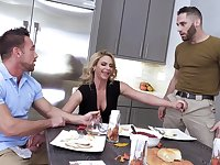 Busty wife Phoenix Marie drops on her knees for two large dicks
